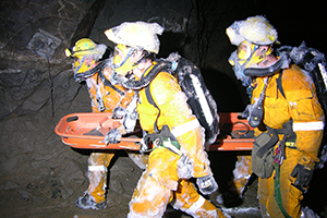 mines rescue case study - rescue team carries stretcher with patient