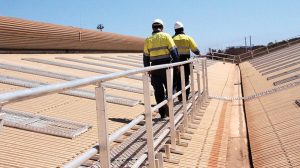managing height safety can be challenging. workers on roof