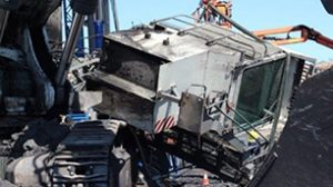mining incident resulting from broken bolts on excavator cab