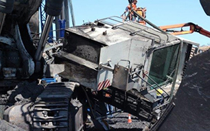 Mining Incident: Broken bolts result in cab falling from excavator