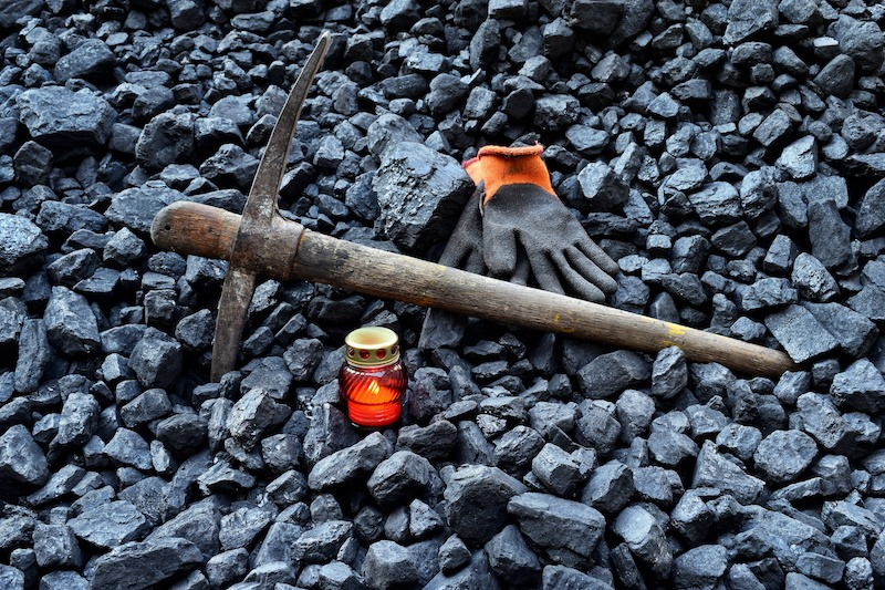 Cut to coal miners accident pay