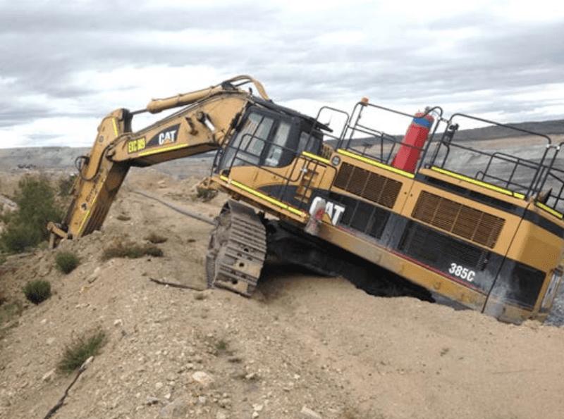 excavator slips over edge