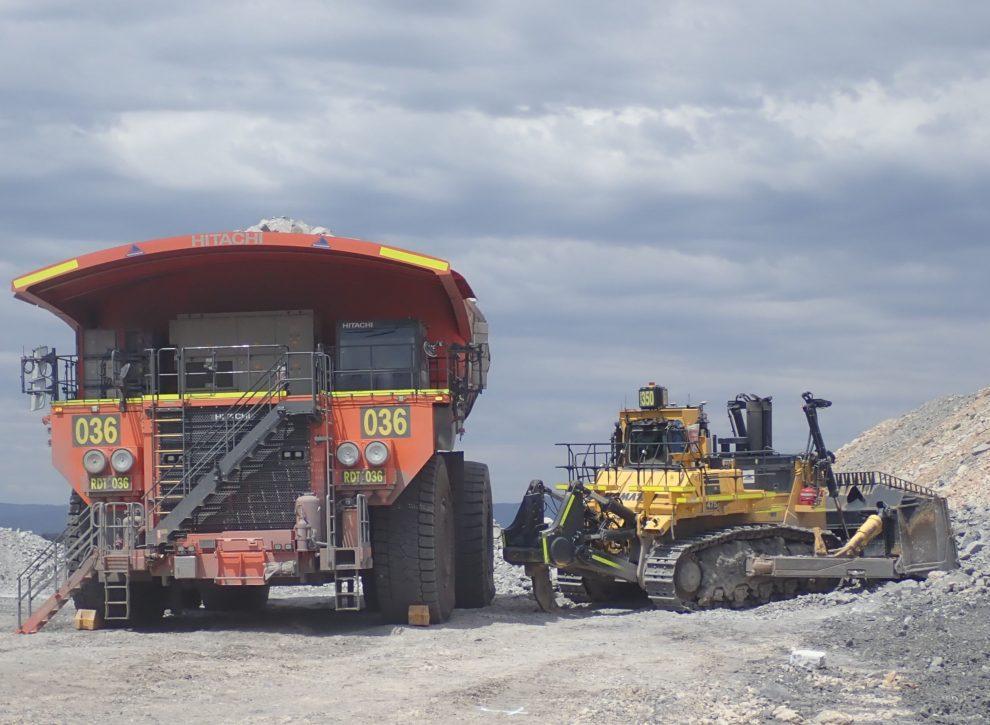 dump truck and dozer collide