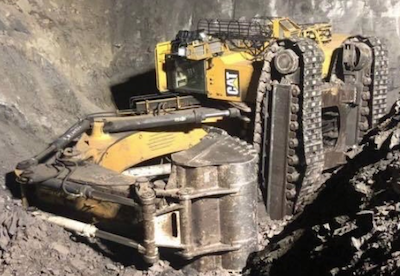 excavator fell from bench in queensland mine