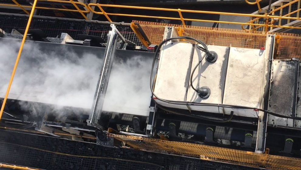 Dry fog dust control solution on a conveyor