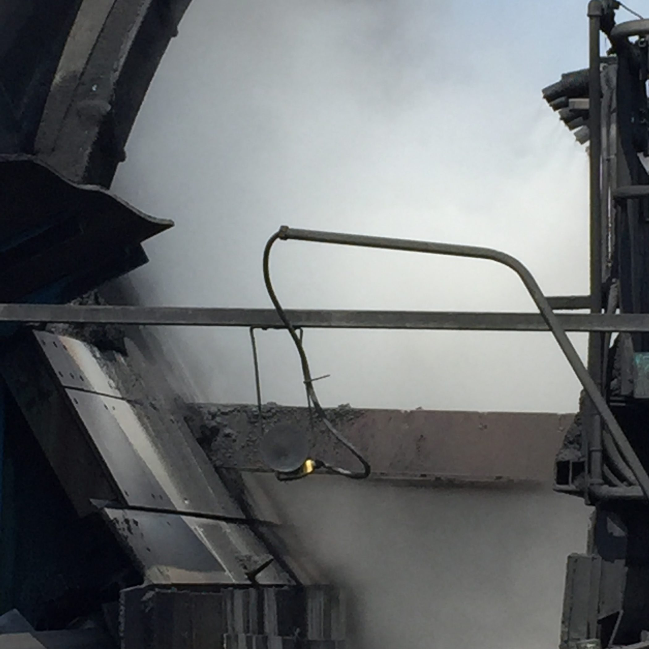 Dry fog dust control on a bucket wheel reclaimer