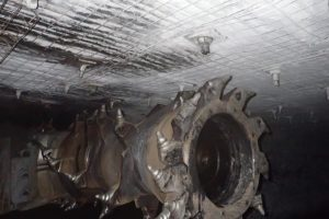 continuous miner driver hit in face by nut from a roof bolt