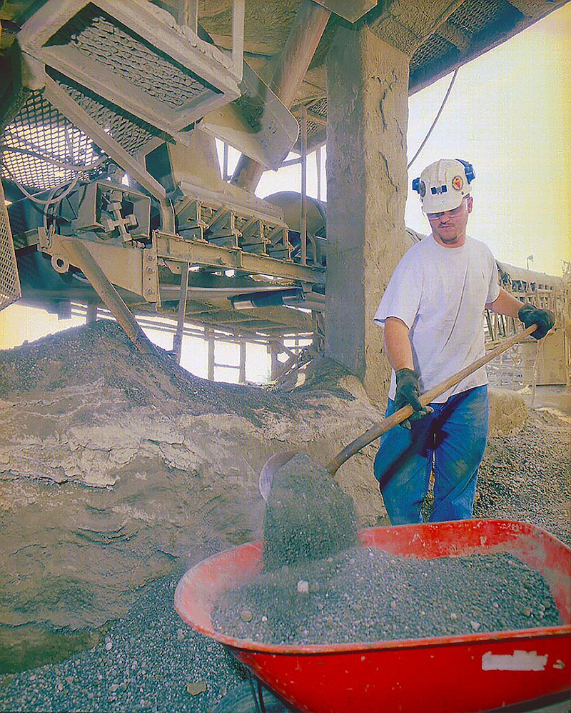 Cleanup brings workers within close proximity of a moving conveyor.