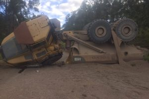 Inexperienced operator rolls dump truck