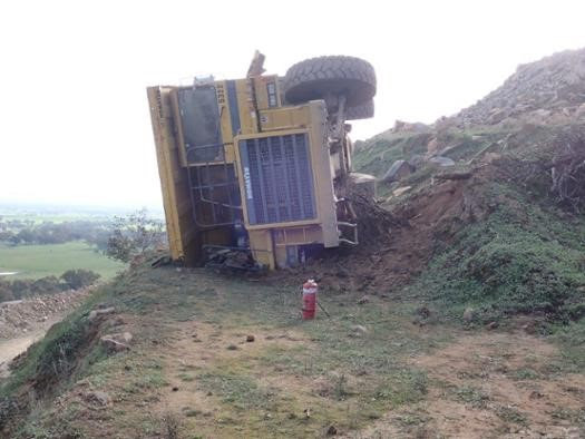 A rigid haul truck rolled over