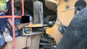 A worker was trapped under the cab of a loader