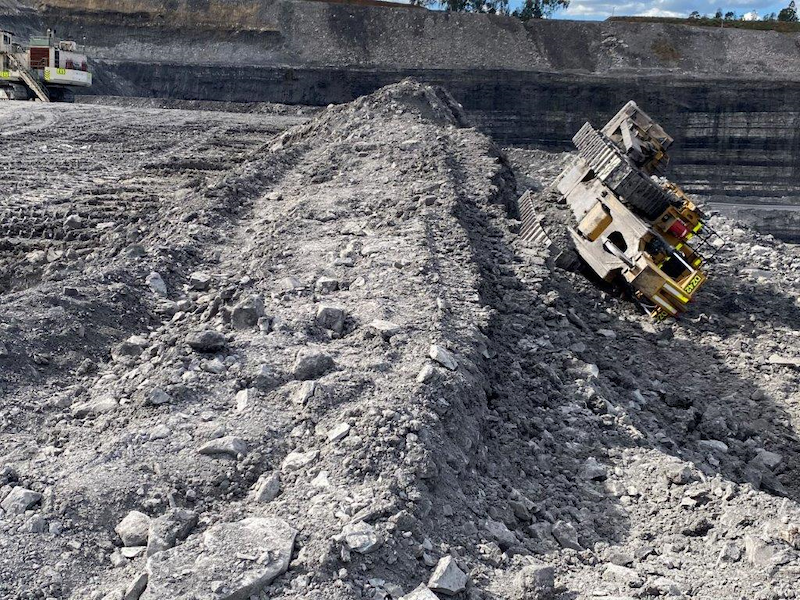 A dozer tipped over incident while levelling windrow