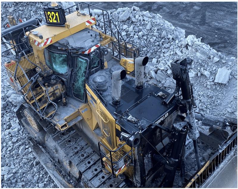 Collision between an excavator and dozer