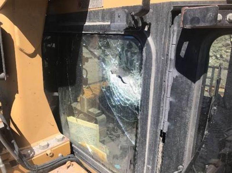 tyre failure ejects rock shrapnel through a dozer's cabin